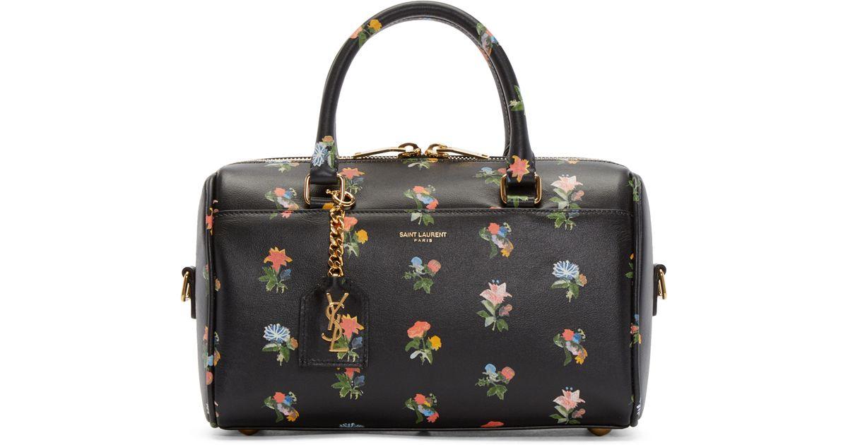 laurent black floral baby duffle bag in black lyst