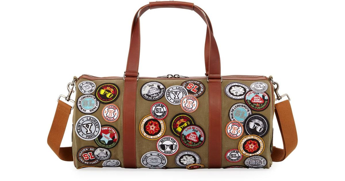 c21a36e1b7 Lyst - Saint Laurent Men s Noe Patches Canvas Duffel Bag in Brown for Men