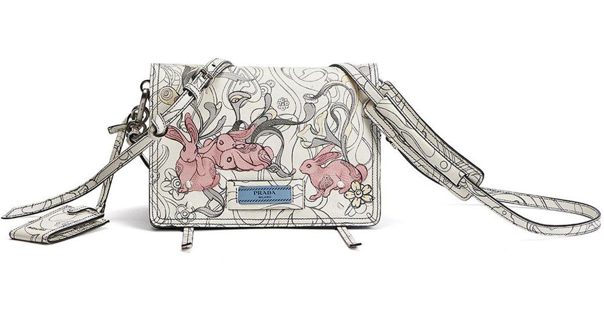 3471b08496bd76 ... clearance lyst prada etiquette small rabbit print leather crossbody bag  in white b7be7 9558a