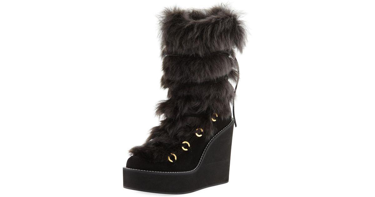 63e1fc872b26 Lyst - Stuart Weitzman Nikita Mid-calf Fur Wedge Boots