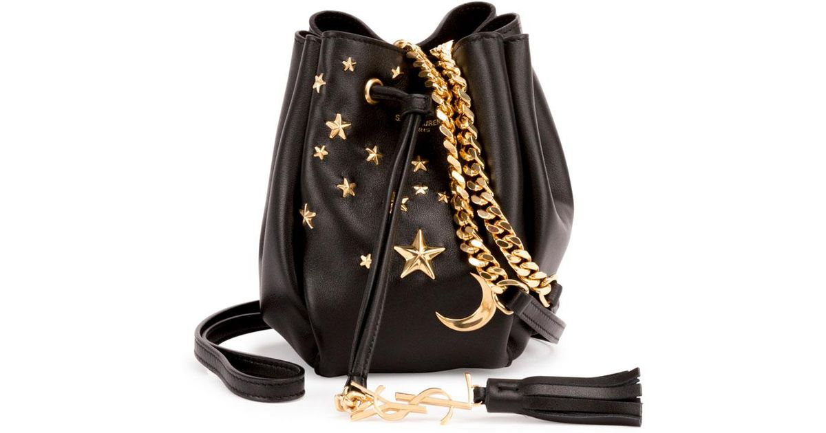 42d4798861899 Lyst - Saint Laurent Monogram Small Star Studded Leather Bucket Bag in Black