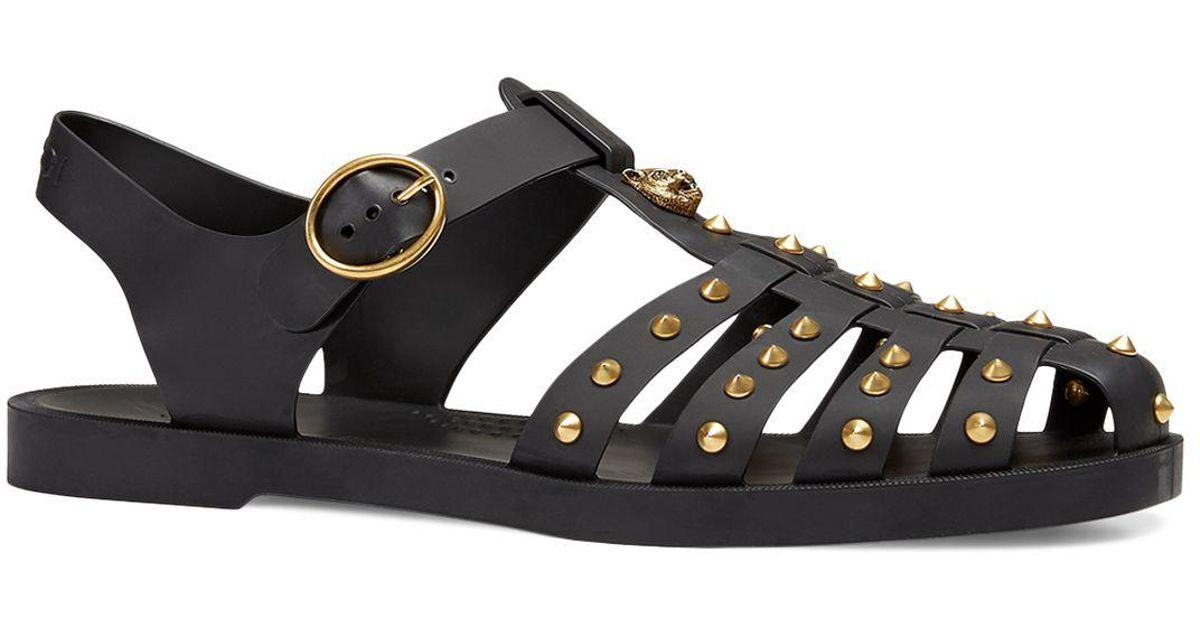 b5a9c0ff9e4 Lyst - Gucci Men s Rubber Buckle Strap Sandals in Black for Men