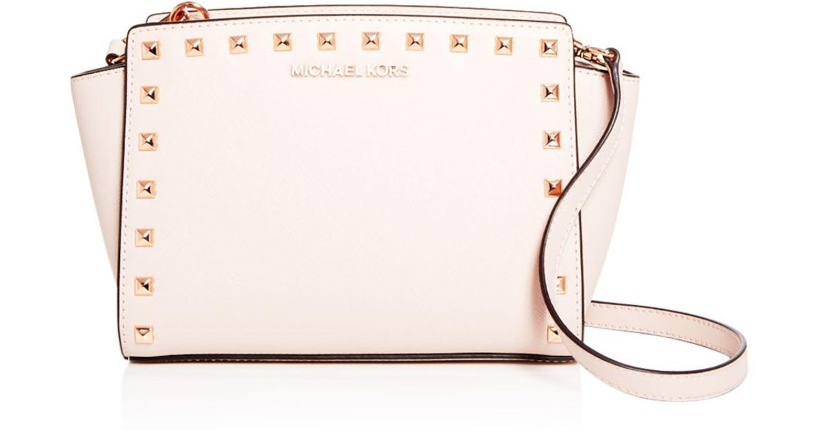 21ed89f765220b ... low cost michael michael kors selma studded embossed leather medium  crossbody in pink lyst ecc31 44372