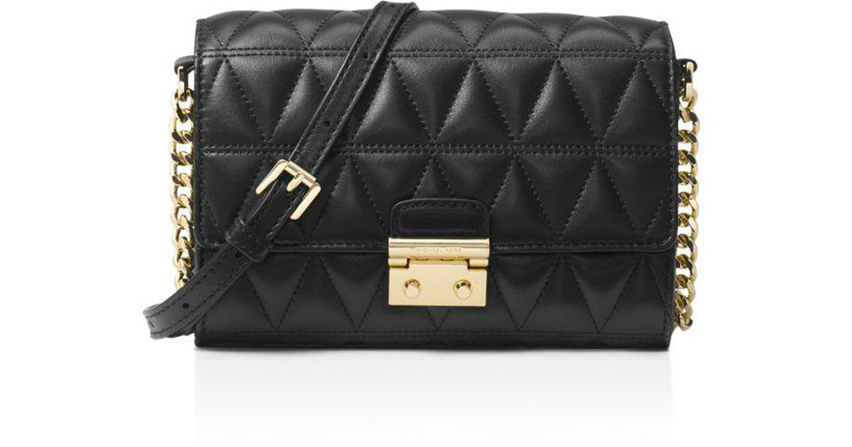 Lyst - MICHAEL Michael Kors Ruby Medium Quilted Leather Clutch in Black 4612778b1117a