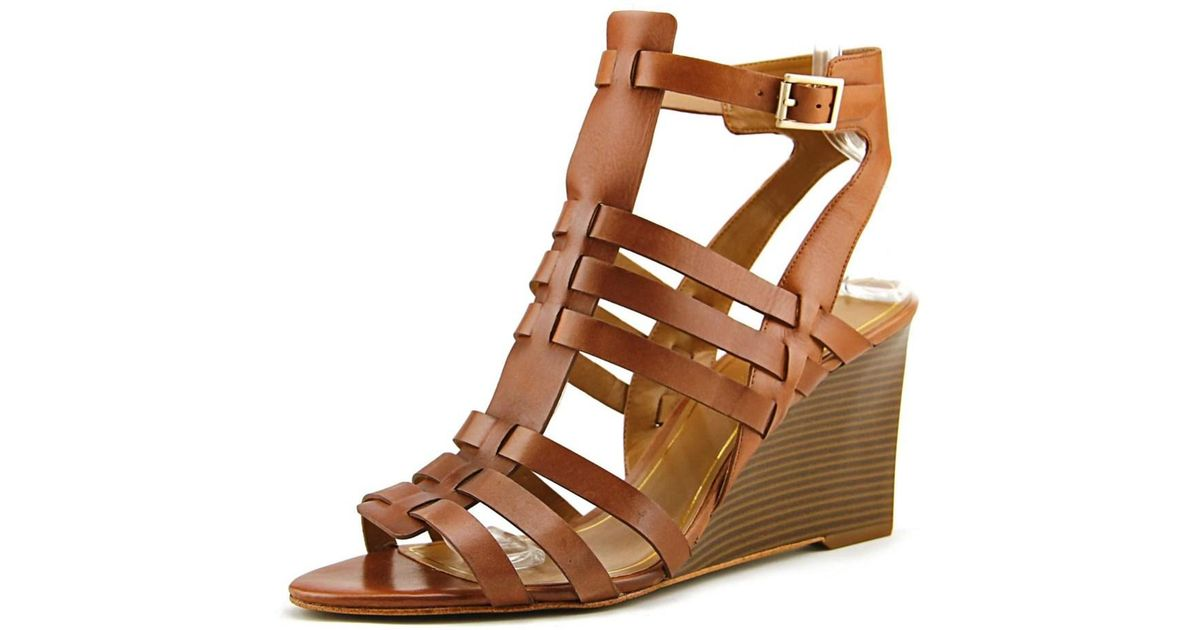 4ac8a41304aa Lyst - Enzo Angiolini Vanhi Open Toe Leather Wedge Sandal in Brown