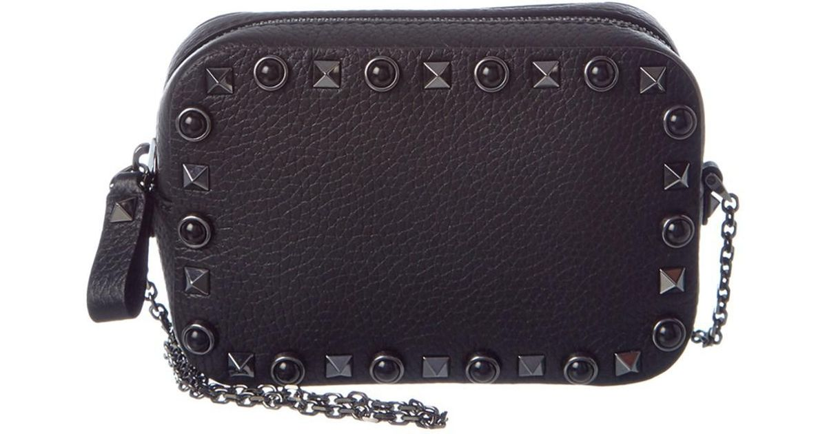 02a7c3cccb527 Lyst - Valentino Rolling Rockstud Noir Leather Chain Camera Bag in Black