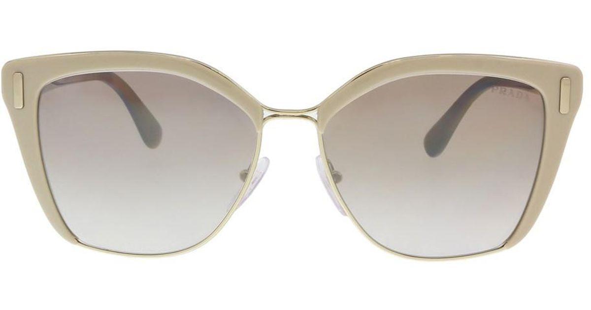 fa30d20b32ab ... free shipping lyst prada pr 56ts vhr4o0 light brown pale gold cat eye  sunglasses in brown