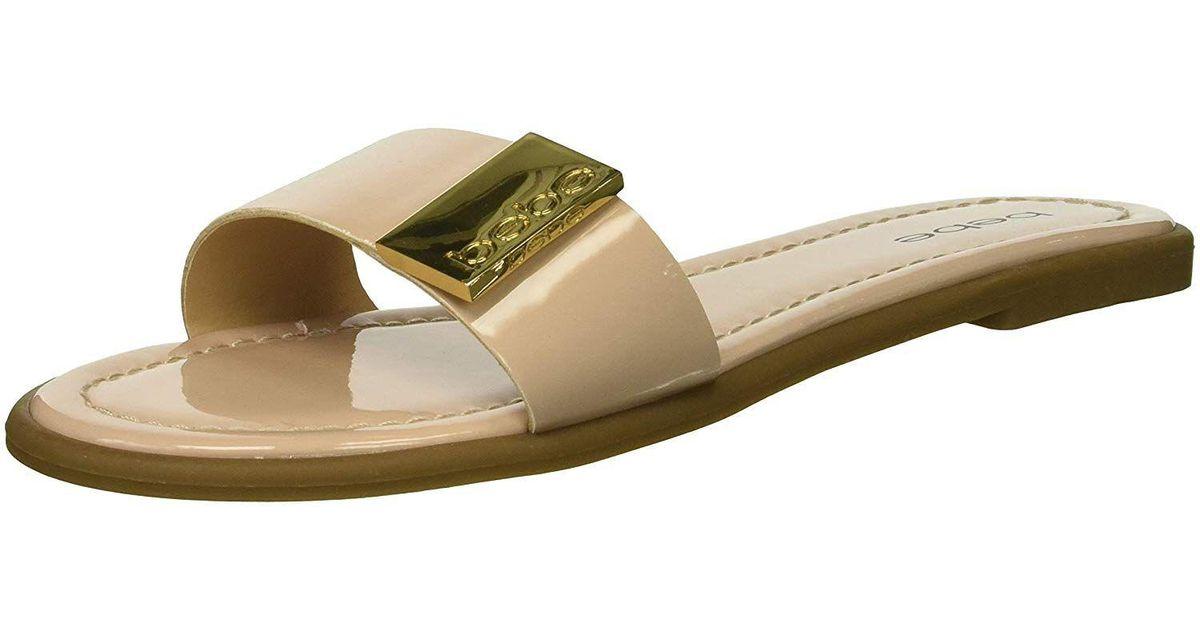 b25a828615a Lyst - Bebe Women s Lania Flat Sandal in Brown