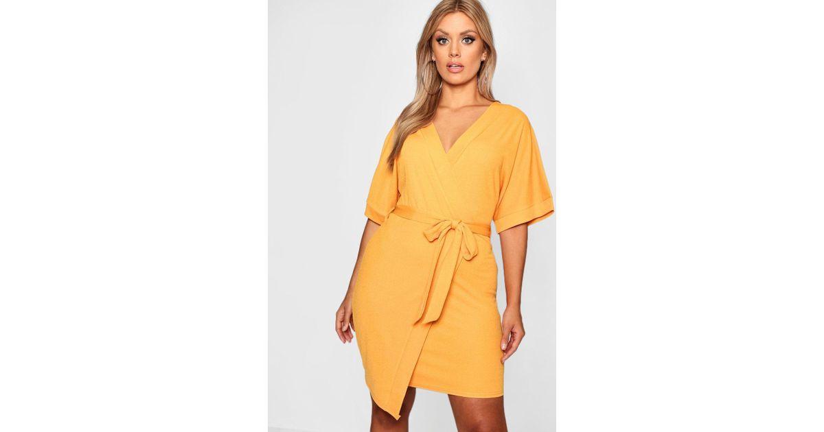 68e16992909c Boohoo Plus Crepe Kimono Sleeve Wrap Midi Dress in Yellow - Lyst