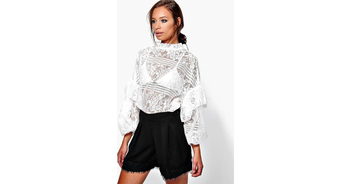 19d9bf35350 Boohoo Mia Lace Ruffle Sleeve Tie Neck Oversize Blouse in White - Lyst