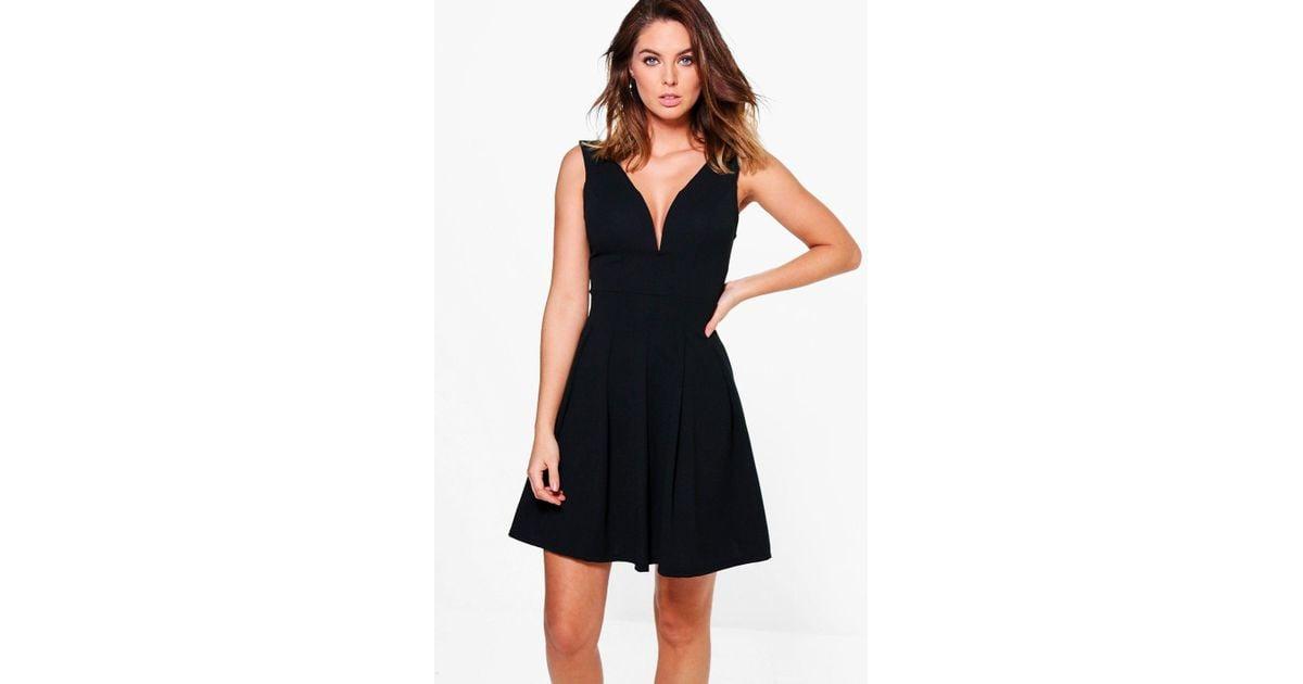 8e2aed1fa8dd Lyst - Boohoo Alessia Low Cut Pleated Skater Dress in Black