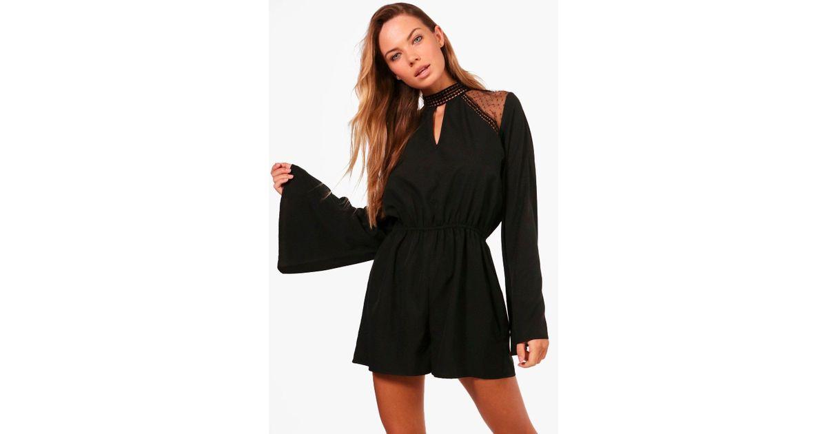 d52526bedfa4 Boohoo Salma Flare Sleeve Lace Insert Playsuit in Black - Lyst