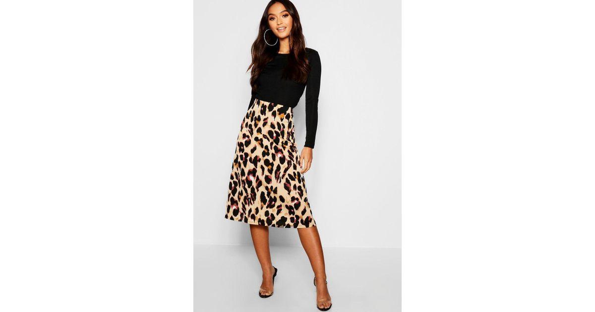 cd160f16c5 Boohoo Petite Leopard Print Bias Cut Midi Skirt in Black - Lyst