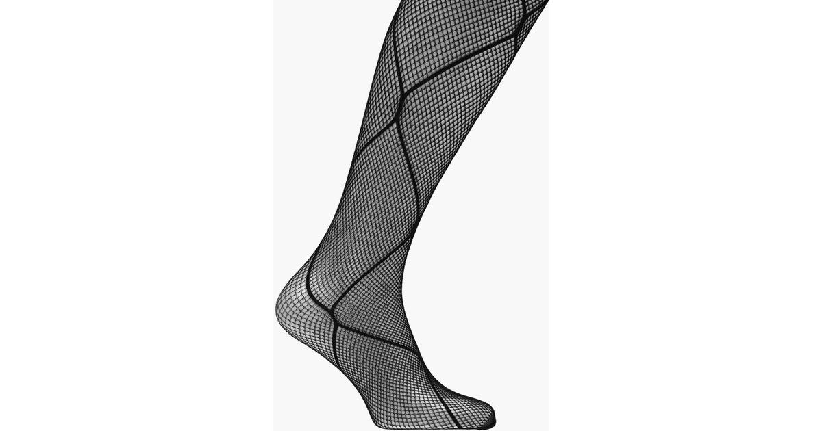 456ede51c028b Lyst - Boohoo Ella Diamond Layover Fishnet Tights in Black