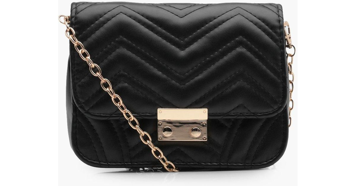 94e7f07112ce Lyst - Boohoo Sarah Zig Zag Quilted Cross Body Bag in Black