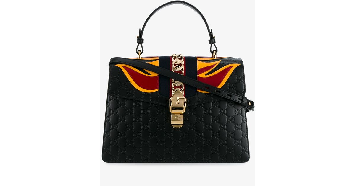 dfc7048ab69 Lyst - Gucci Sylvie Bag With Flames