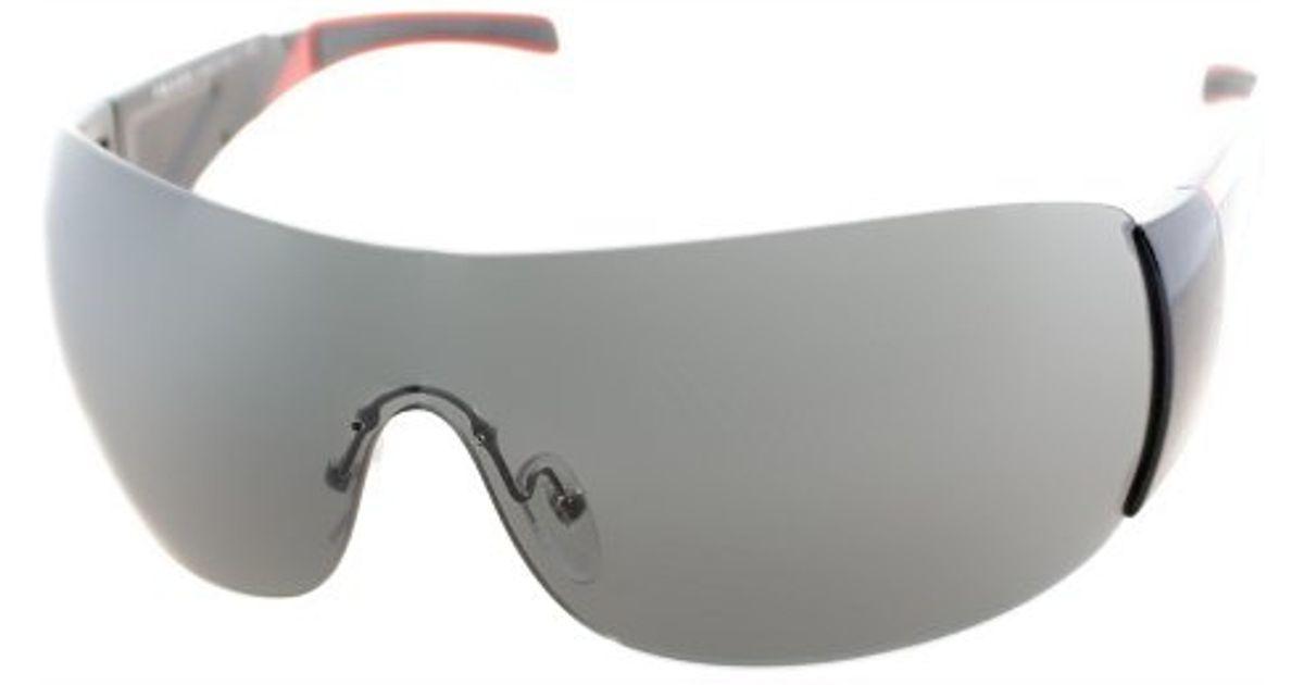 39966ee0e7 ... closeout lyst prada linea rossa ps 07hs 7ov1a1 gloss black and grey  shield sunglasses grey lens ...
