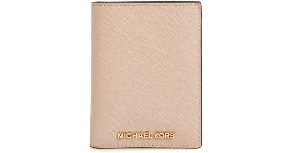 aea70d962a50 Lyst - Michael Kors Michael Travel Passport Wallet in Pink