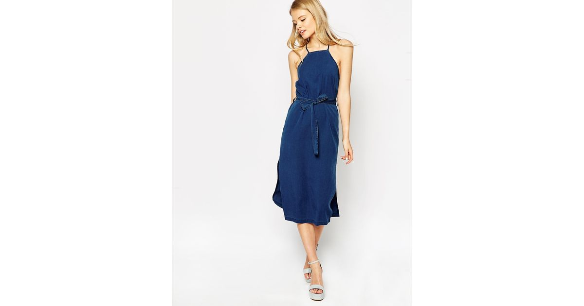 dd8c60d9932 Lyst - ASOS Denim Cross Back Halter Midi Dress With Tie in Blue