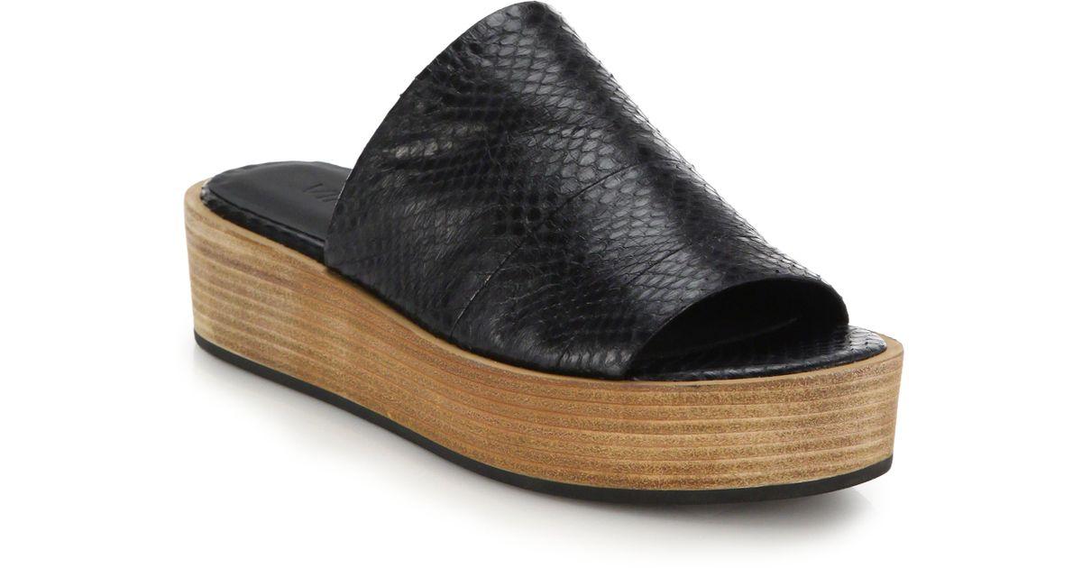 b5f3689147d Lyst - Vince Saskia Snakeskin-embossed Leather Platform Slide Sandals in  Black