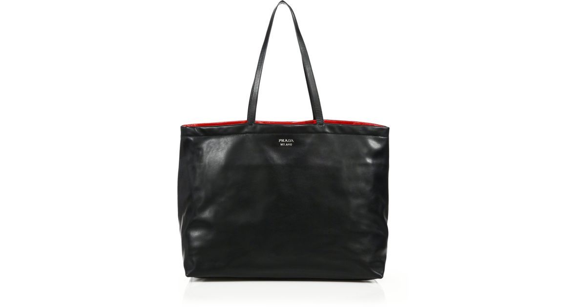 0cf24924b863 Lyst - Prada Soft Calf Reversible Tote in Black