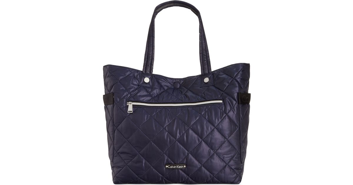 97966ade9d Lyst - Calvin Klein Cire Reversible Extra Large Quilted Nylon Tote in Blue