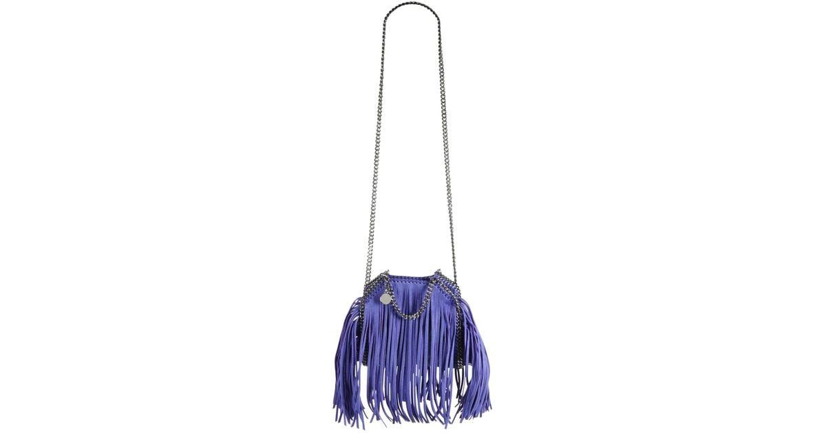 Lyst - Stella McCartney Tiny Bella Fringe Fold-over Bucket Bag in Blue 03ac8a6ccc01a