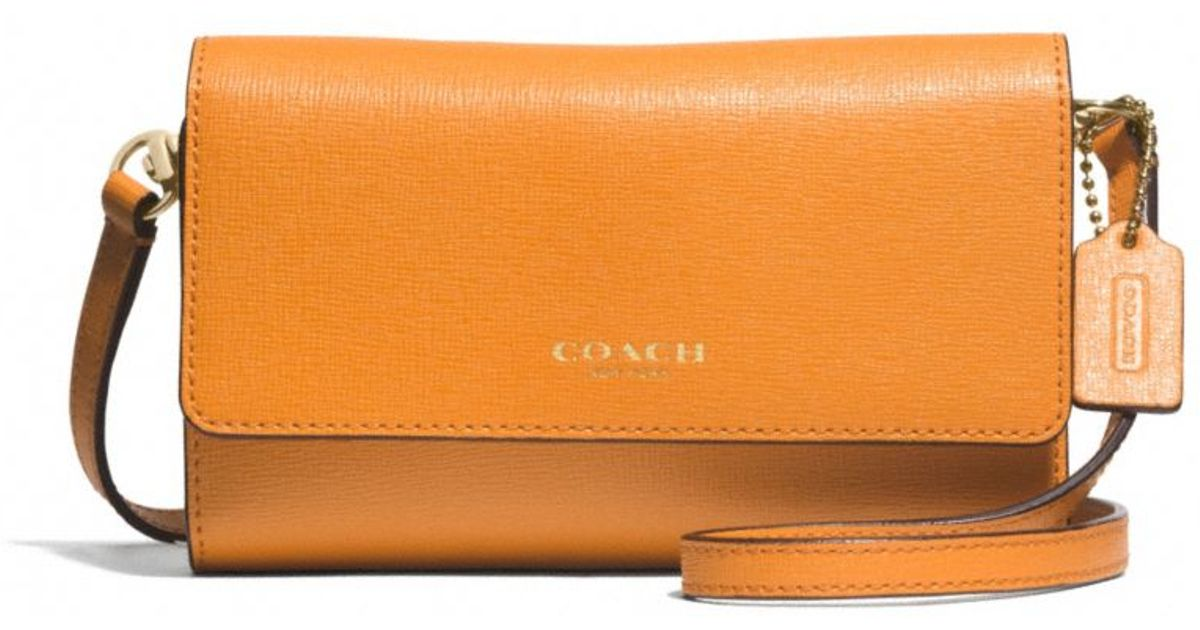 dcc0375187 Lyst - COACH Phone Crossbody in Saffiano Leather in Orange