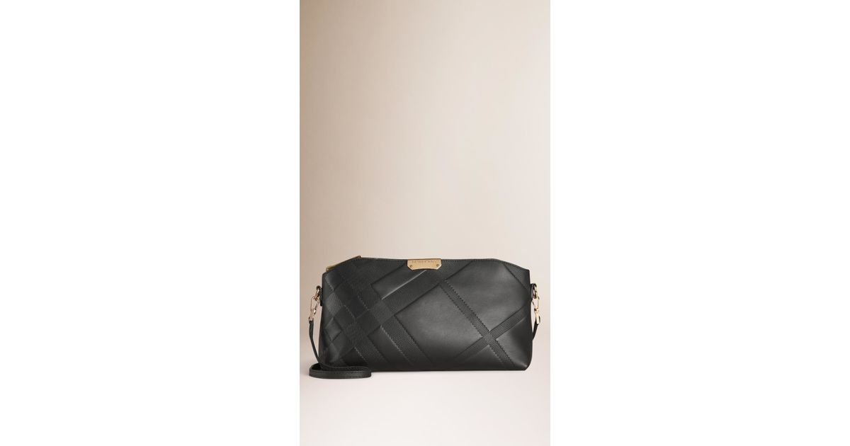 e7608b46dd48 Lyst - Burberry Small Embossed Check Smooth Leather Clutch Bag Black in  Black