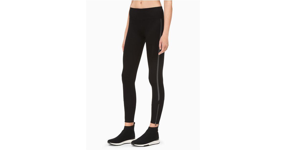 b7ccaf7a4c360 Lyst - Calvin Klein Performance Reflective Stripe Leggings in Black