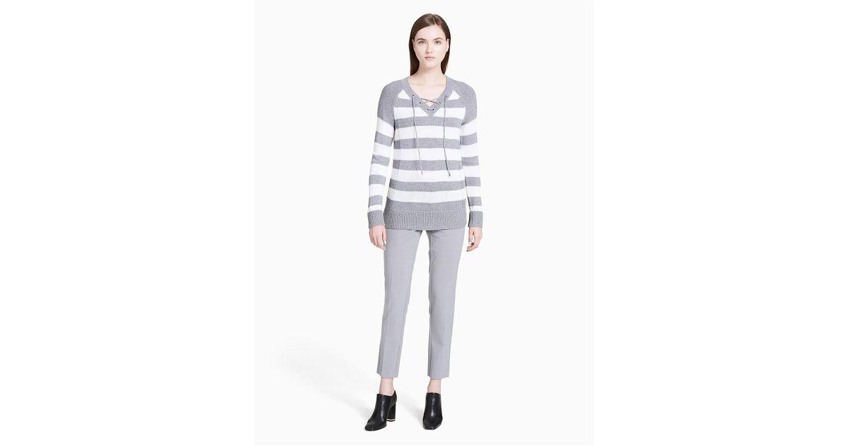 5ca9e176f7 Lyst - Calvin Klein Striped V-neck Lace-up Sweater in Gray