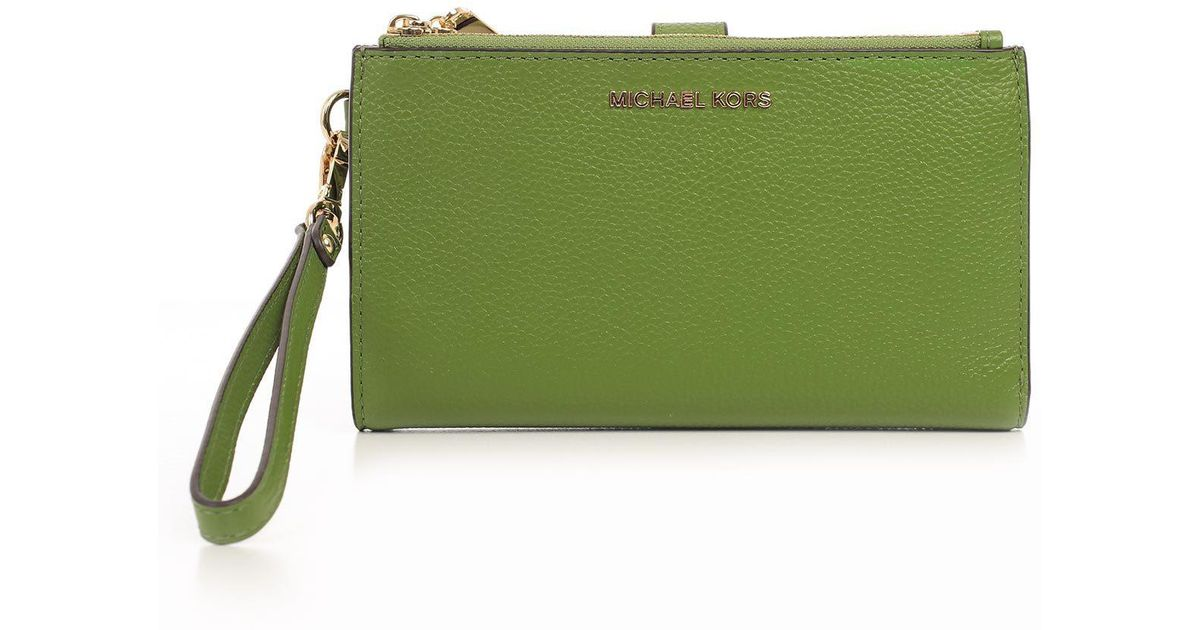 4eb2ad7a952ae3 Lyst - MICHAEL Michael Kors Leather Wrist Pouch in Green