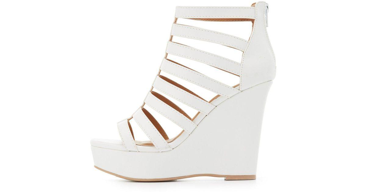 4b91cdf1ec047 Lyst - Charlotte Russe Caged Platform Wedge Sandals in White