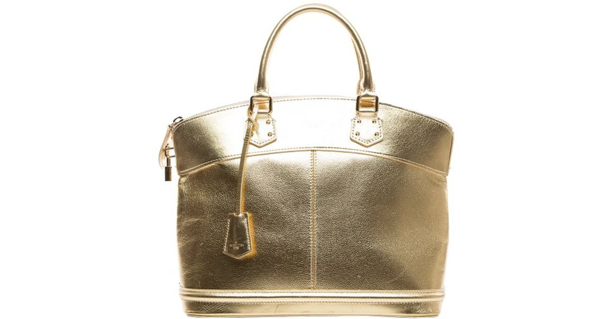 f3ccafb346b1 Louis Vuitton Pre-Owned Gold Suhali Lockit Pm Tote Bag in Metallic - Lyst