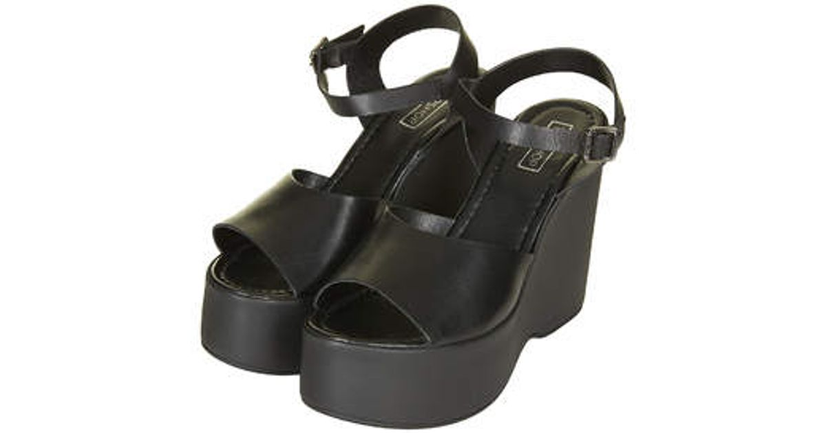 d4c0c506411b6 Lyst - Topshop Wallflower Wedge Sandals in Black