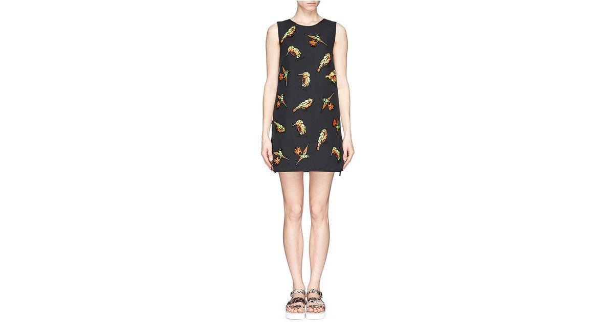 Lyst msgm neon bird appliqué wrap back dress in black