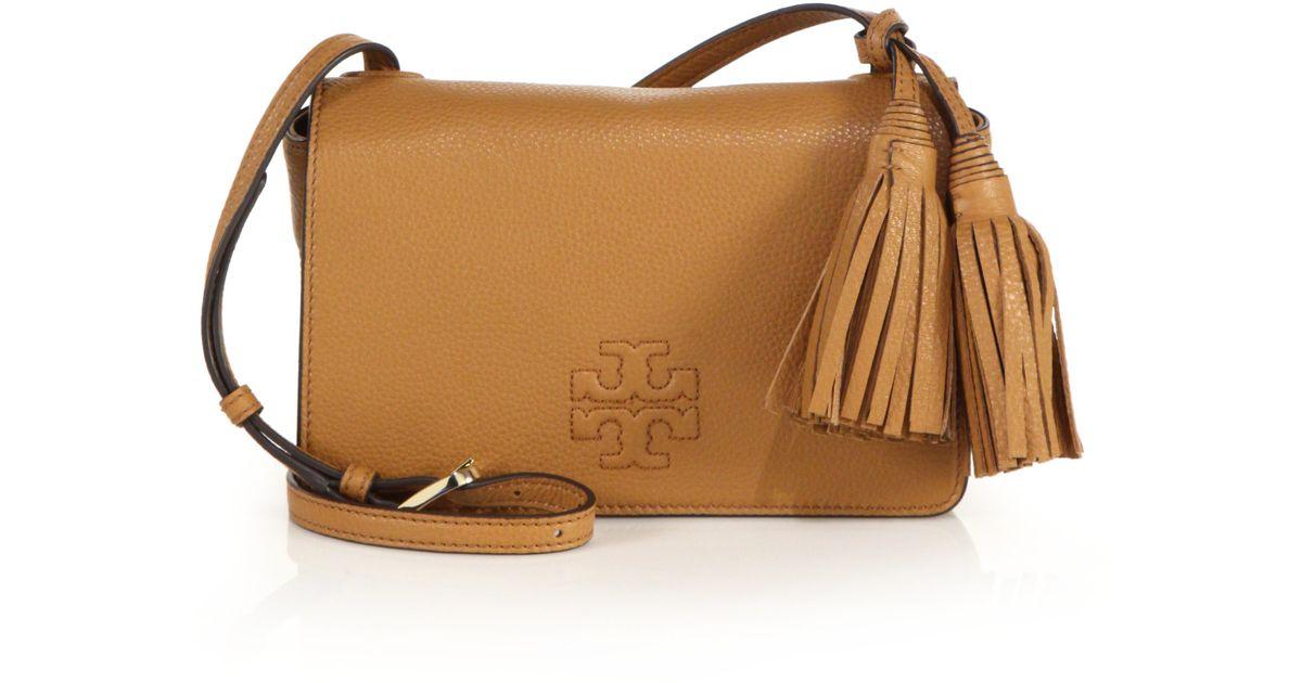 f32b62458d71 Lyst - Tory Burch Thea Mini Leather Tassel Crossbody Bag in Natural