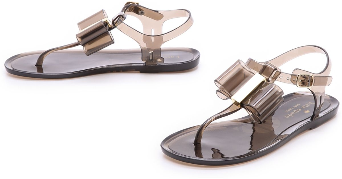 3f362da76 Lyst - Kate Spade Filo Jelly Thong Sandals in Brown