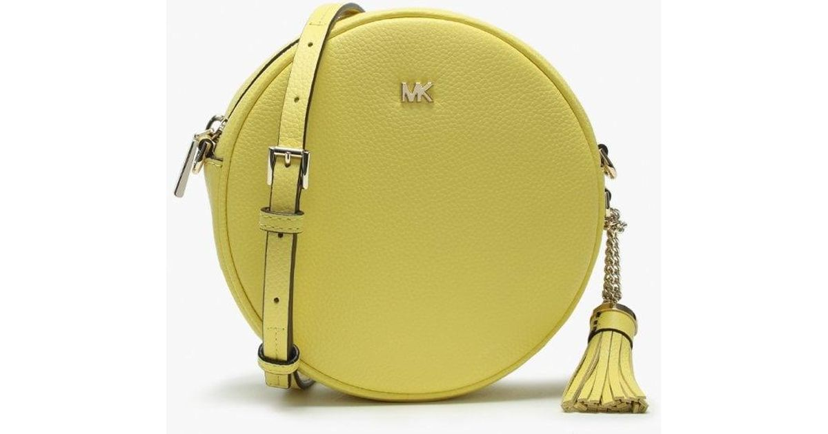 9bab15ac2e711a Lyst - Michael Kors Canteen Sunshine Leather Circular Cross-body Bag in  Yellow