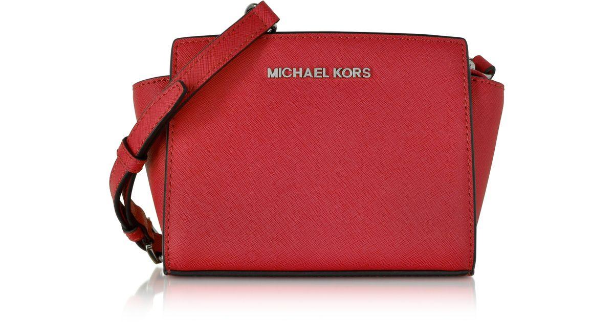 b3471b00df81 Lyst - Michael Kors Selma Saffiano Leather Mini Messenger in Red