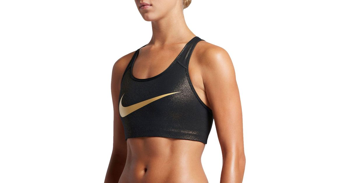 5565f5b6697932 Lyst - Nike Pro Classic Swoosh Printed Sports Bra in Black