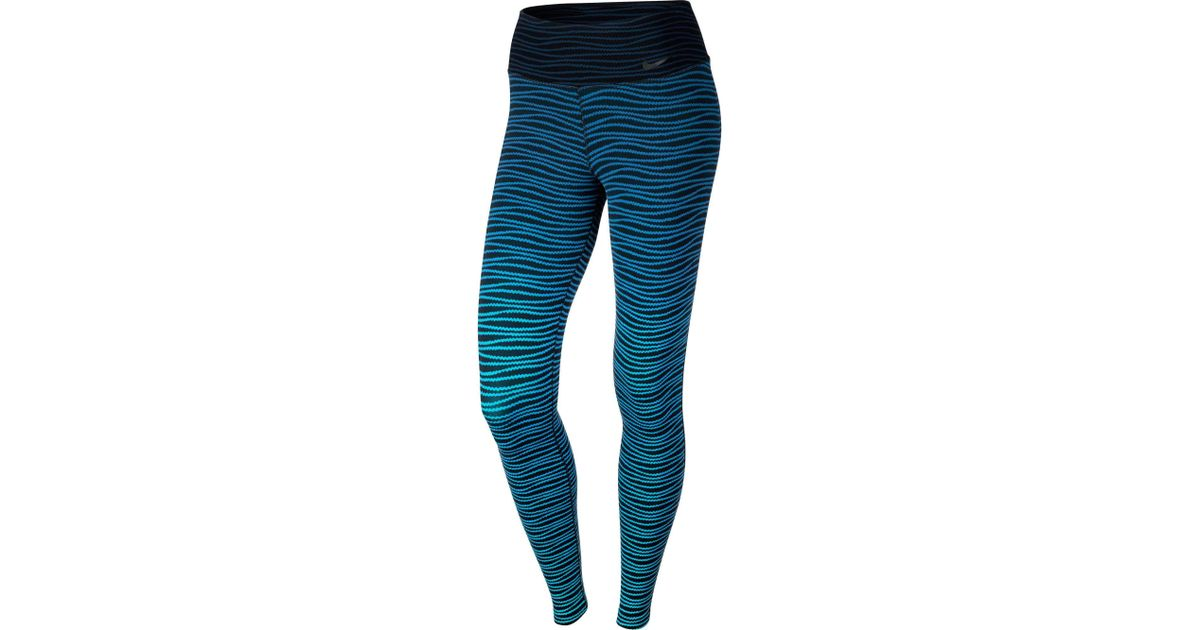 4f6e5426c8ca54 Nike Legendary Engineered Swell Printed Tights in Blue - Lyst