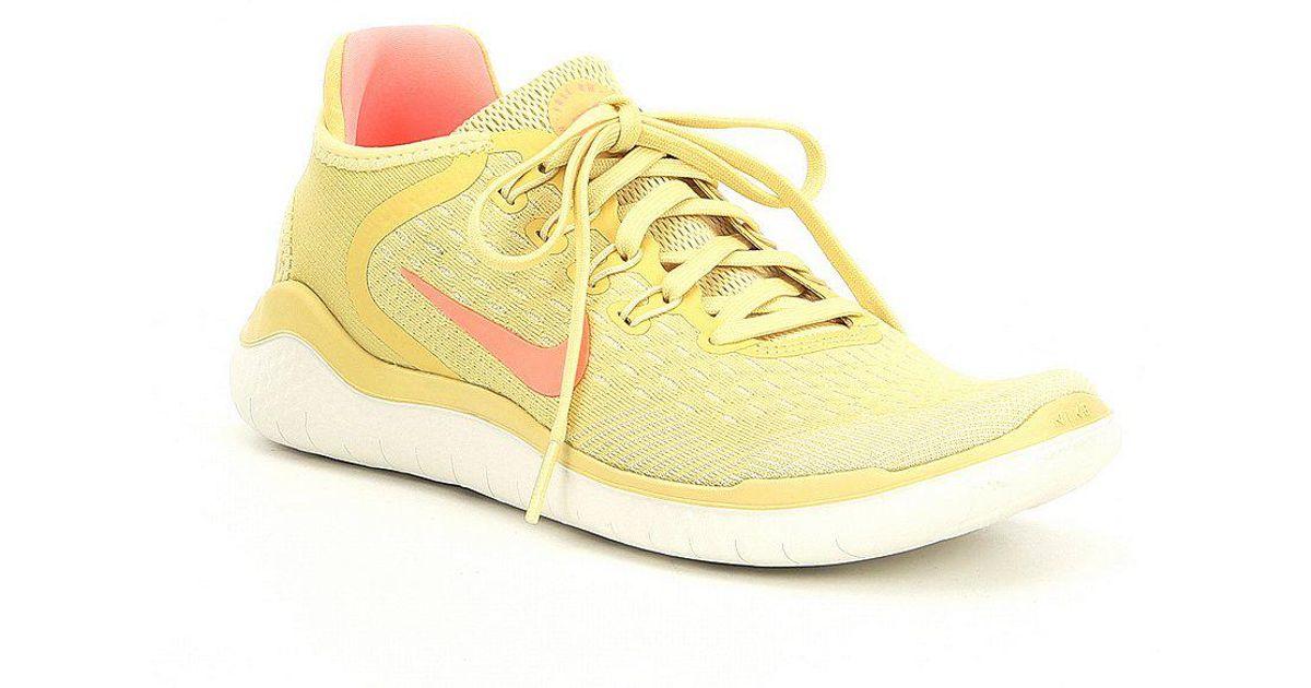 34061aa1cf0d5 ... sale lyst nike womens free rn 2018 summer running shoes in yellow cbee3  bcae7
