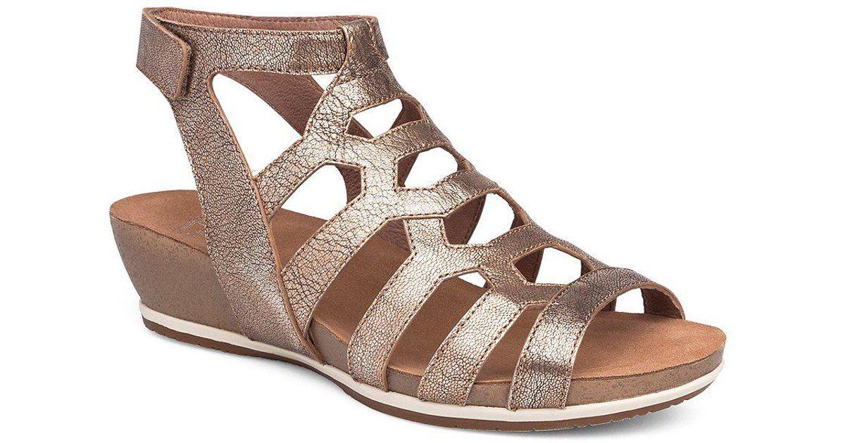 83260df61cb0 Lyst - Dansko Valentina Leather Gladiator Wedge Sandals in Brown