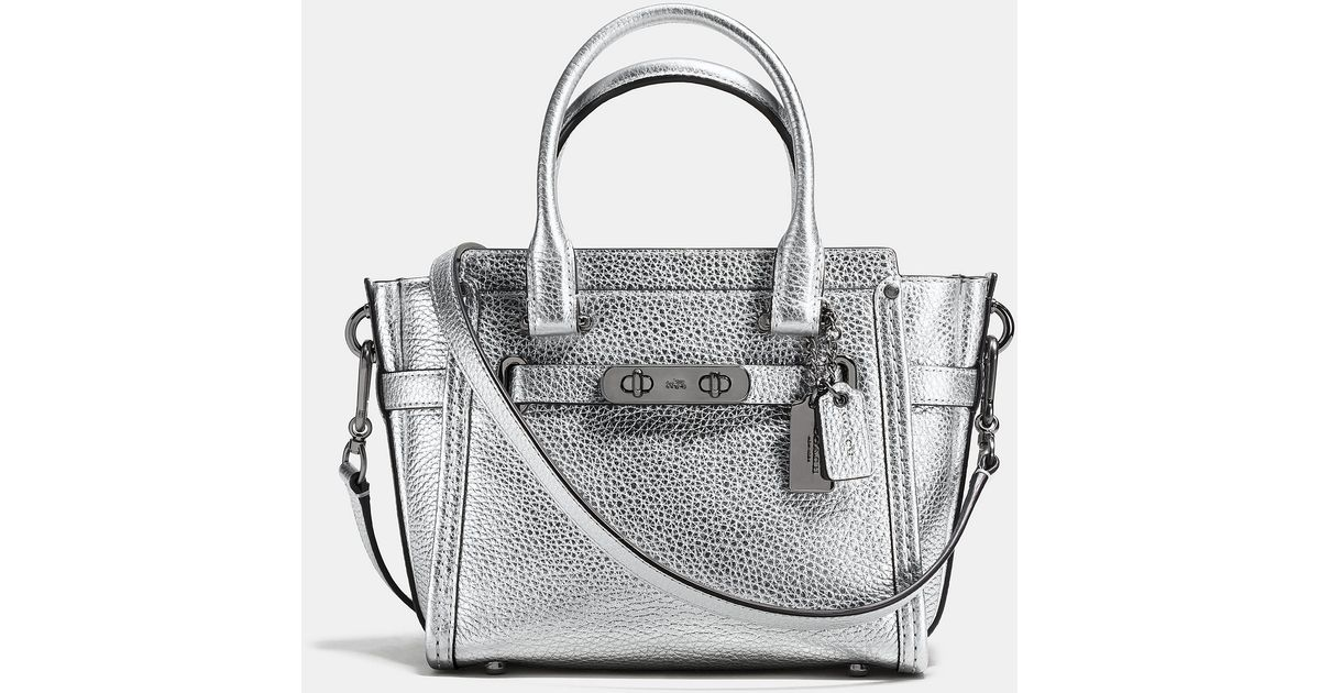 dbbc3cd3ab Lyst - COACH Swagger 21 Carryall In Pebble Leather in Metallic