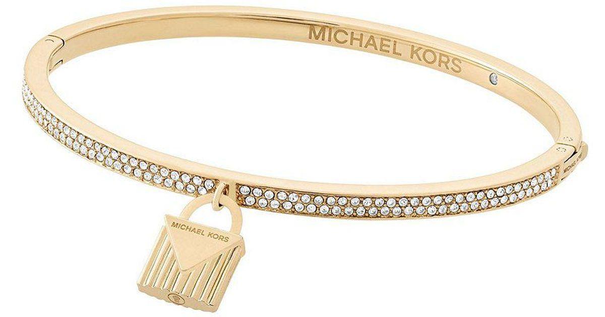 Lyst Michael Kors Logo Love Bangle Bracelet With Padlock Charm In Metallic