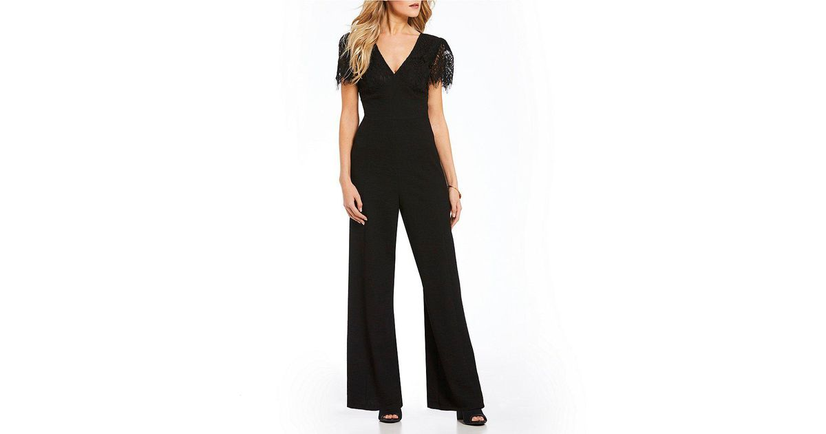 e969a44130ef Lyst - June   Hudson Lace Sleeve Jumpsuit in Black
