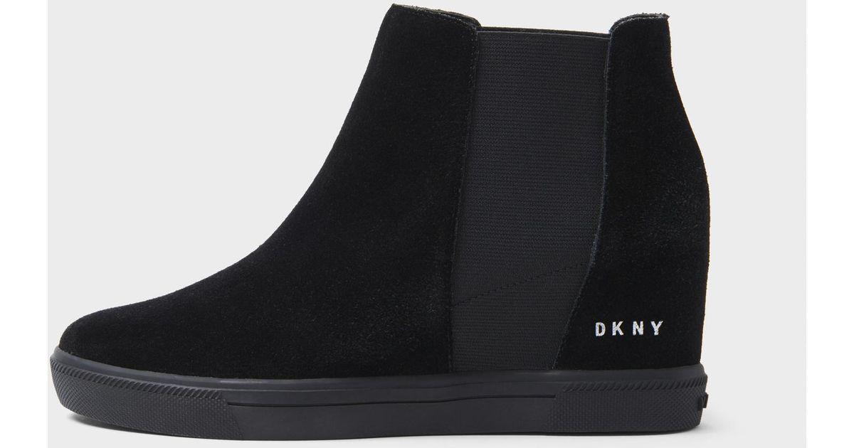 85bed18f4d41 Lyst - DKNY Chelsea Sport Suede Wedge Sneaker in Black
