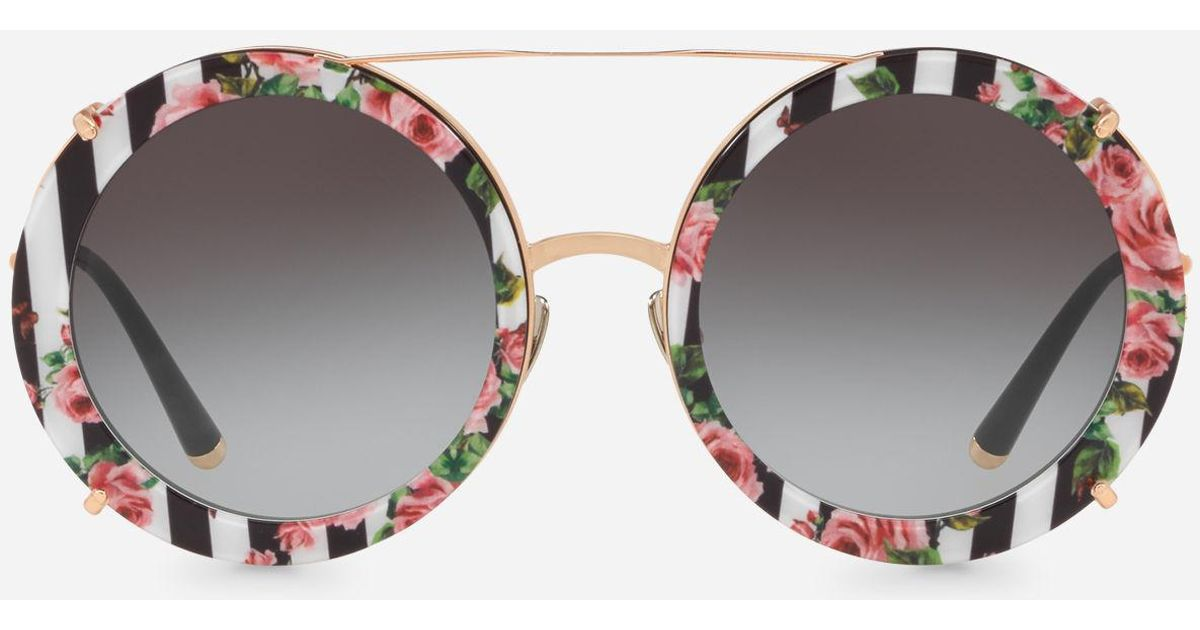 832493d73bb Lyst - Dolce   Gabbana Round Clip-on Sunglasses In Gold Metal With Stripe  And Rose Print in Metallic