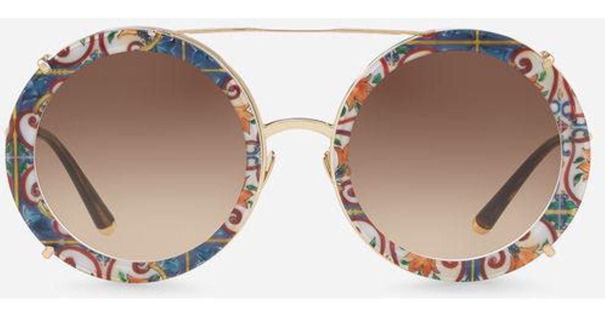 ec430c5dd422 Dolce   Gabbana Round Clip-on Sunglasses In Gold Metal In Majolica Print -  Lyst